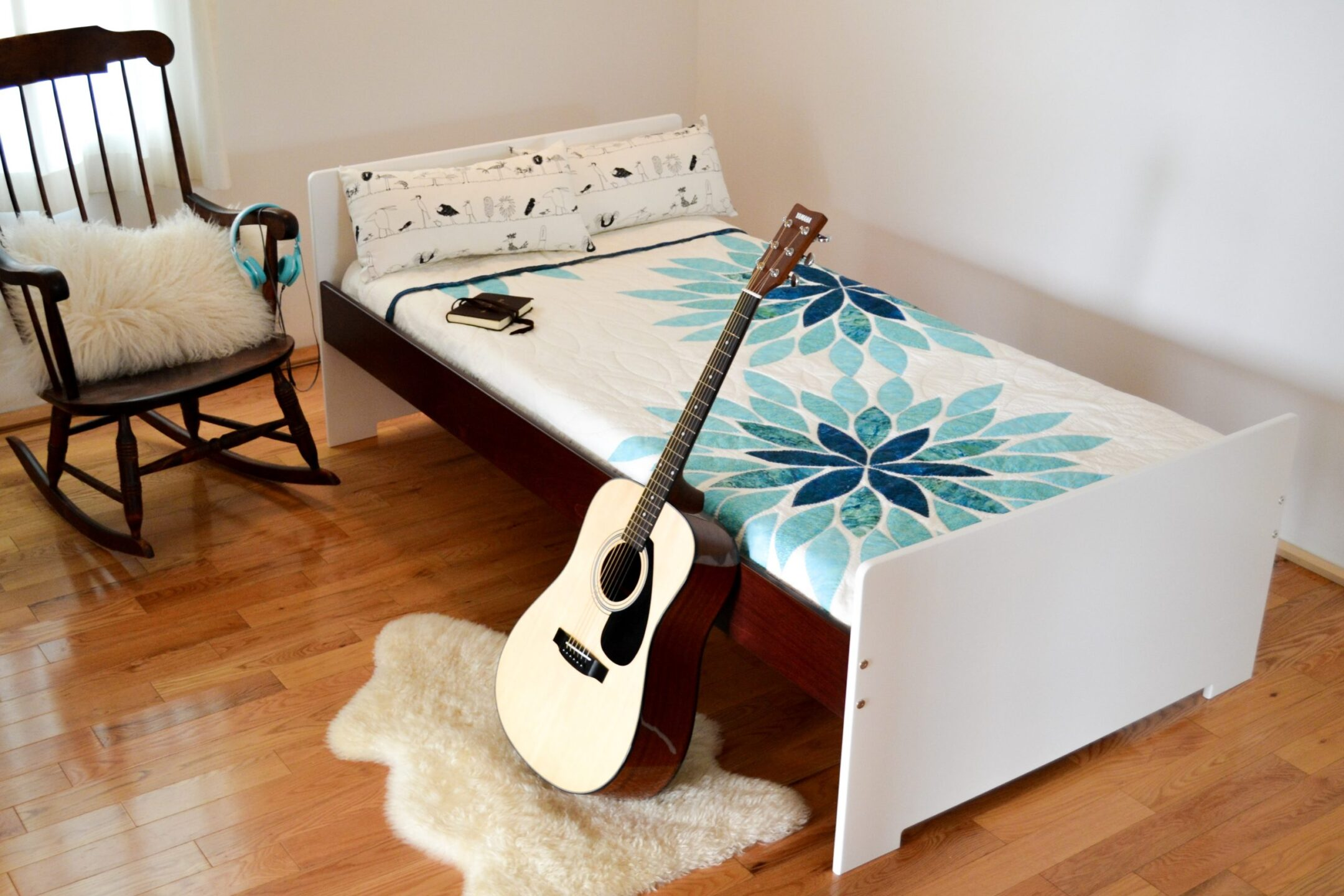 Birch multiply bed finished in an eco friendly varnish with white paint and a dark brown stain.