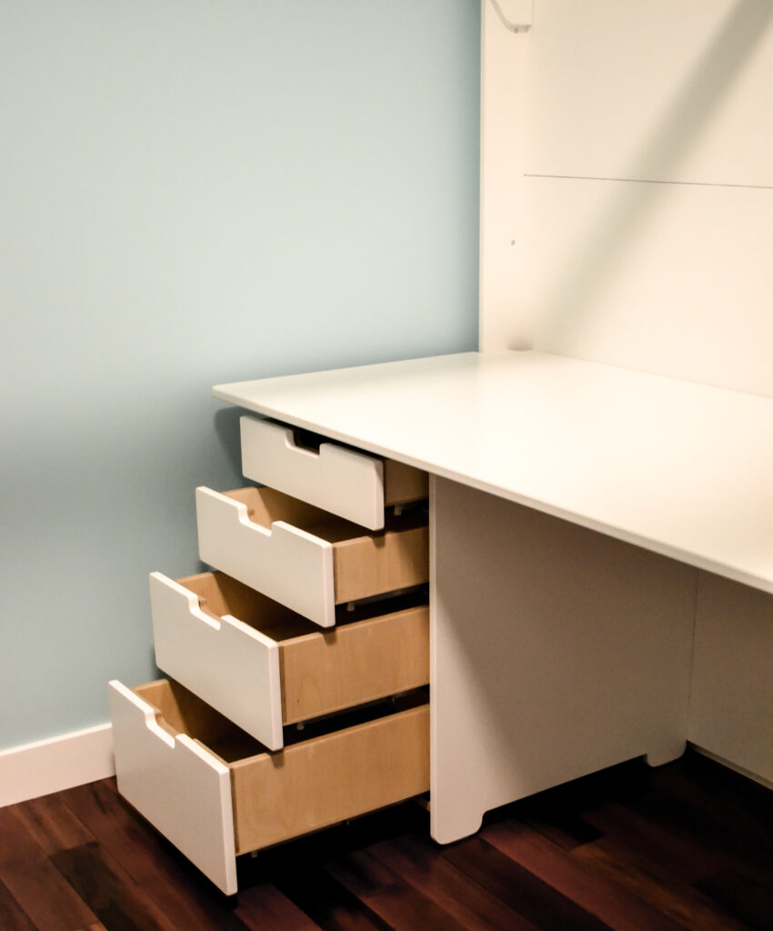 Desk storage drawer unit under a custom made birch multiply bunk bed finished in white using an eco friendly varnish.