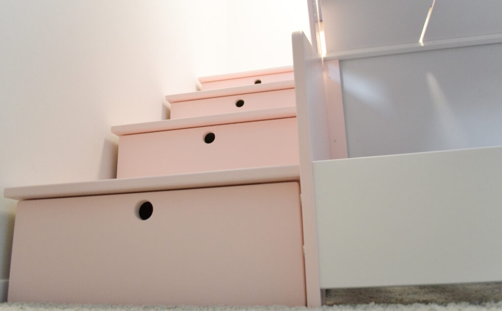 Staircase storage drawers with soft closing drawers next to our birch multiply bunk bed designs.