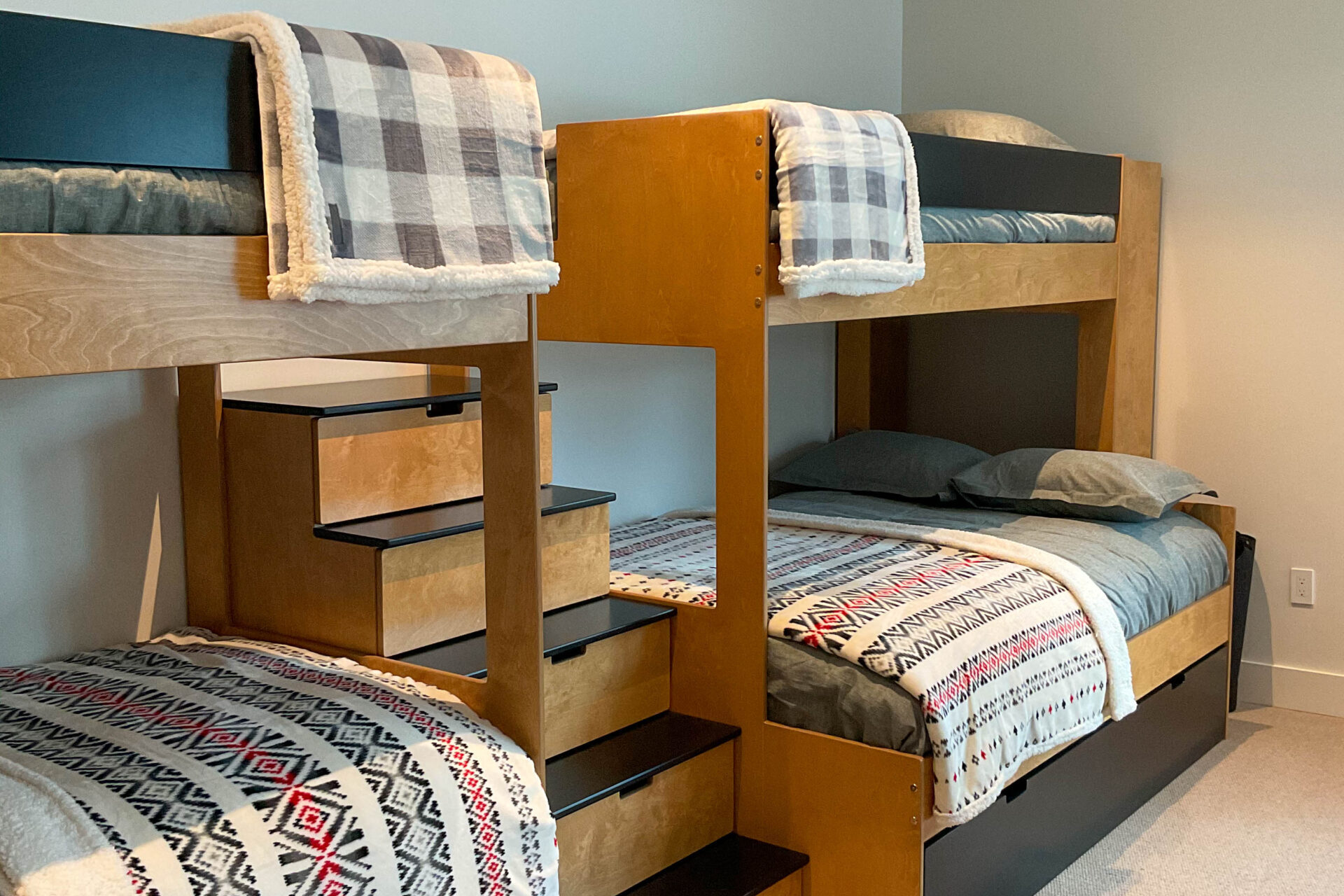 styled bunk beds showing two bunk beds with blankets and pillows